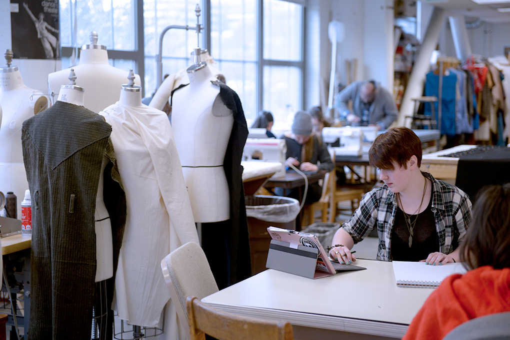 Performance Production student working on Costume Design in large studio with mannequins