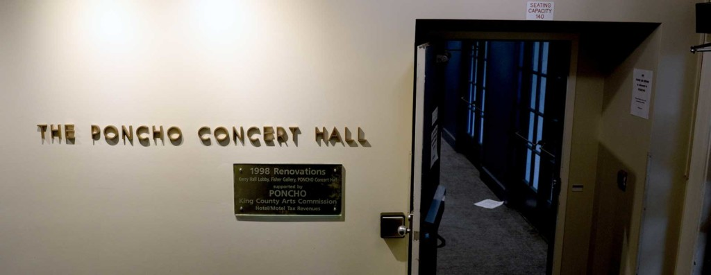Entrance to Poncho Concert Hall showing decorative lettering and a commemorative plaque