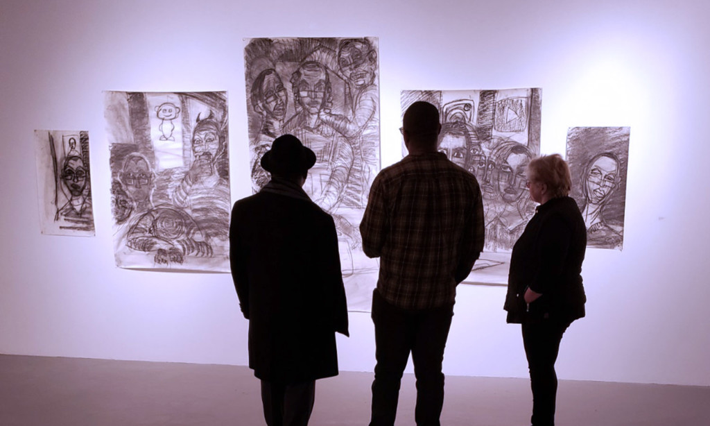 viewers at exhibit