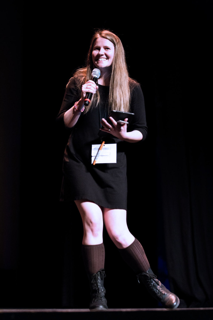 A person holding a microphone.