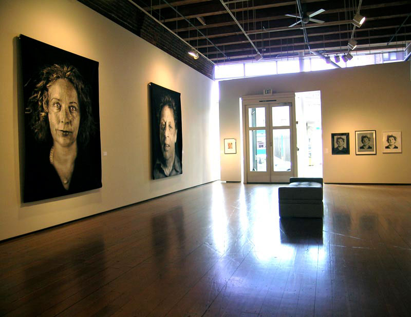A gallery exhibit of portraits.
