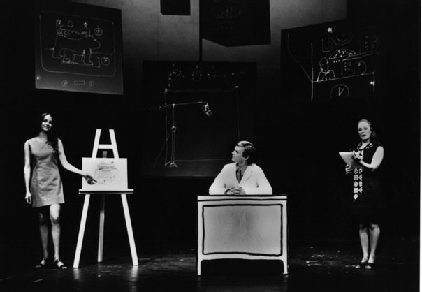 Three people on a stage.