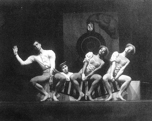A black and white photo of dancers on a stage.