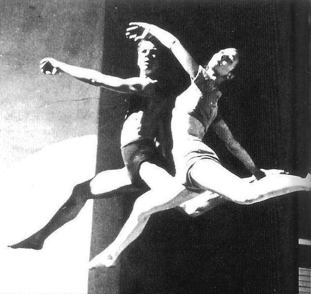 A black and white photo of two dancers.
