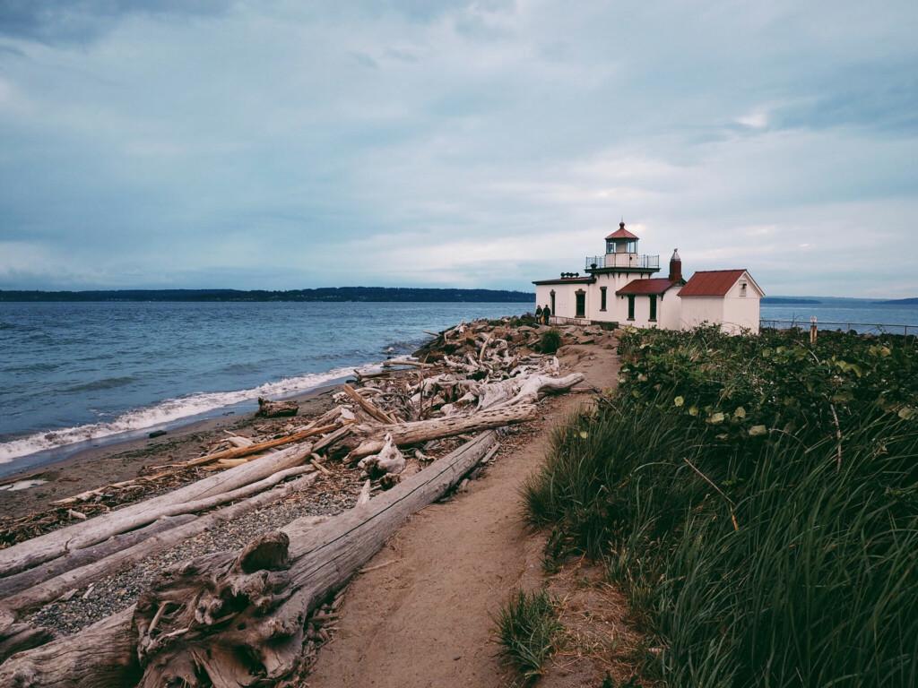 A lighthouse on a beach.